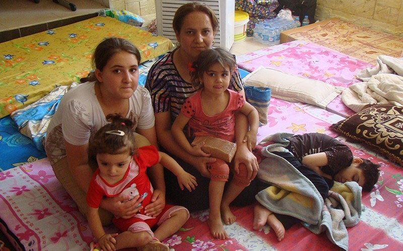 PROVIDING AID AND SCRIPTURE TO IRAQI CHRISTIANS FLEEING MILITANTS